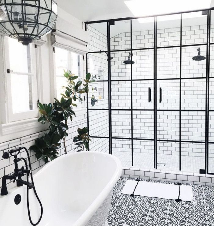 Bathroom with black hardware framed shower doors and white patterned encaustic tile floor designed by life style la via dream also hanging out in bathrooms chandeliers that add  touch