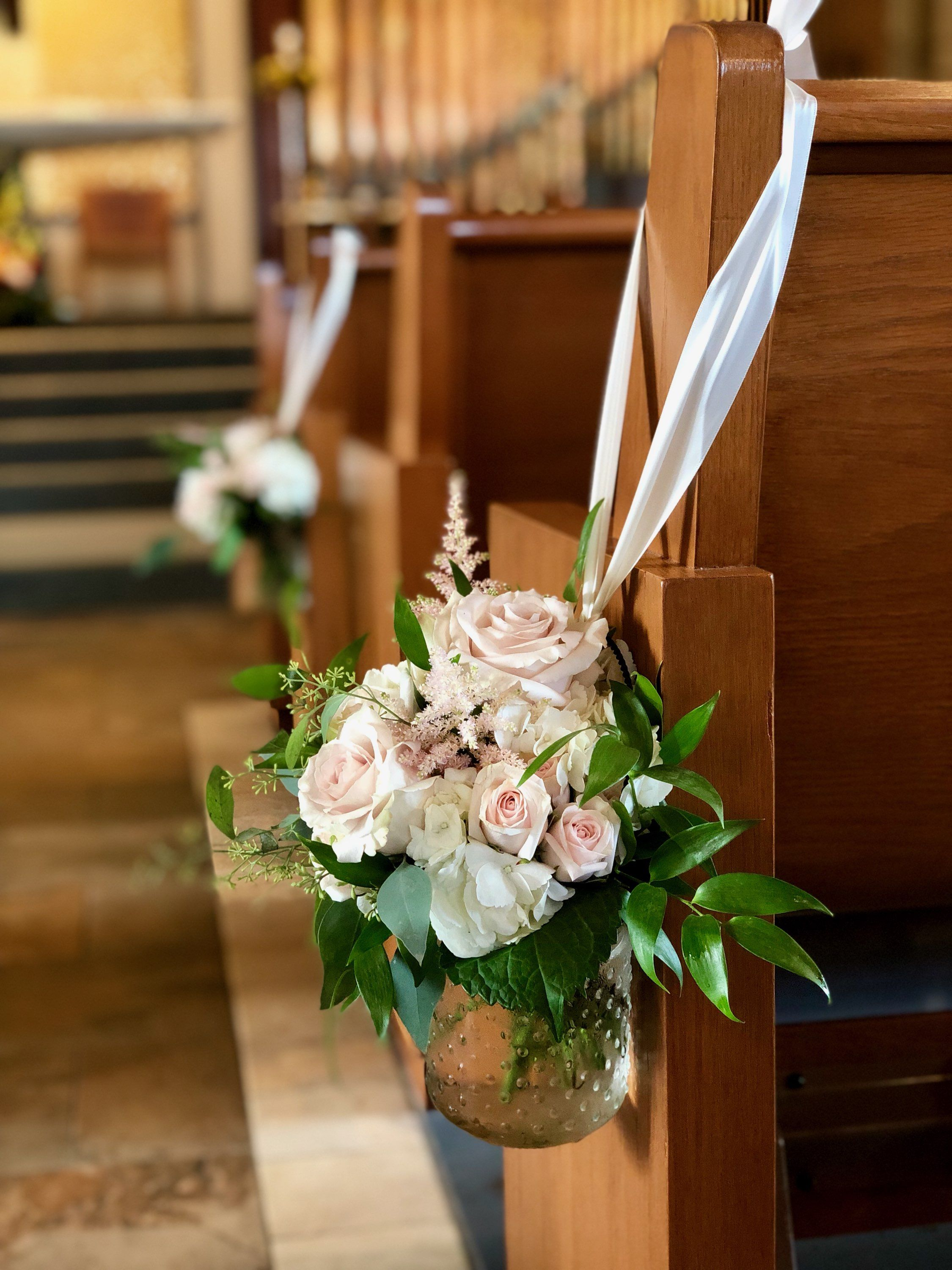 Dress up your aisle with hanging vases designed by