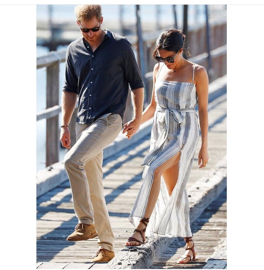 8fdac7f67fbd Meghan Markle shamed for wearing dress with thigh-high slit while on tour  with Prince Harry