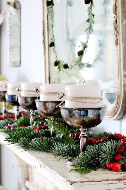 you can't go wrong with silver and fresh greens for a Christmas mantlescape... so pretty