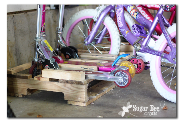 tutorial on making a scooter and bike rack out of a pallet - - how to get scooters to store standing up