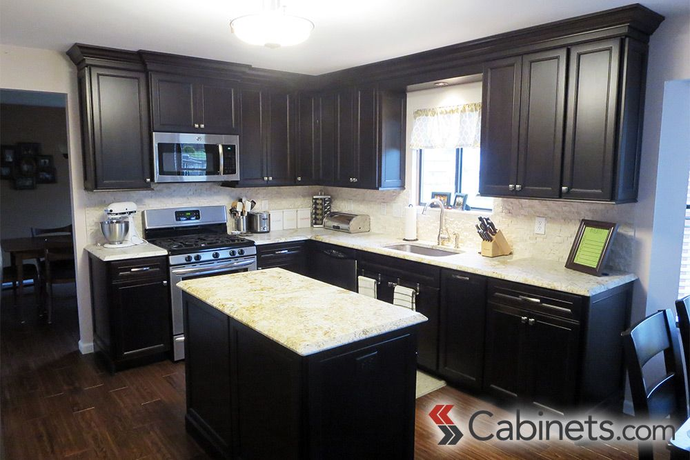 Beautiful Dark Kitchen Featuring Belleair Maple Espresso Cabinets On The Perimeter And Island Espresso Cabinets Online Kitchen Cabinets Dark Stained Cabinets