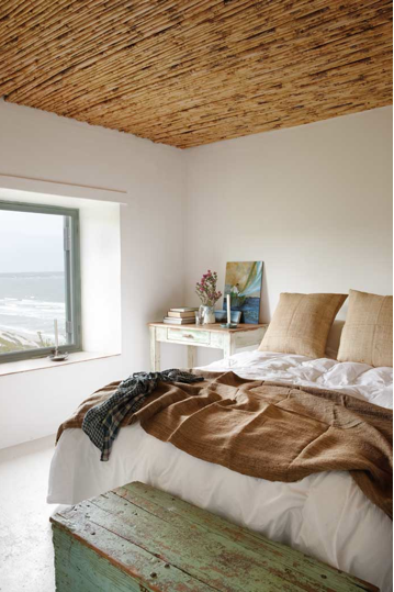 lovely beachy feel bedroom I love the earth tones and that the accent wall is the wood ceiling
