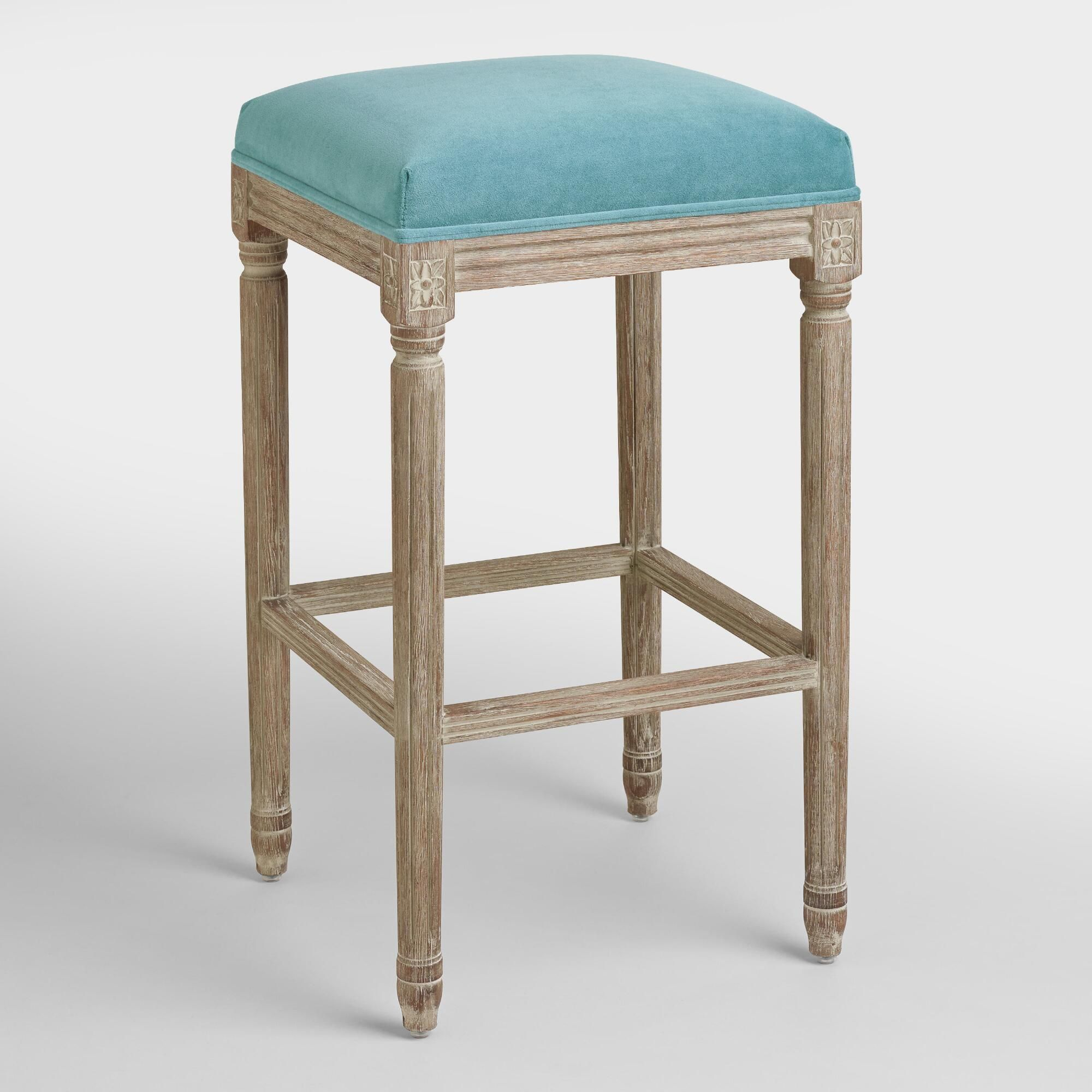 An elegant take on a classic our peacock paige backless barstool is crafted of american white oak with carved details and a distressed finish
