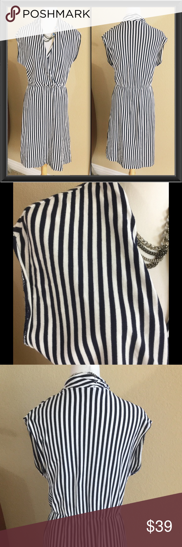 "Anthropologie Navy/White stripe cotton dress Saturday Sunday for Anthropologie Navy/White stripe cotton dress. Very soft wrap front dress with elastic waist band. Would look great with a belt which then could be worn shorter if desired. Wonderful condition. Measures 42.5"" long Aprox 18.5"" across bust and 14"" at waist but have lots more room because of the elastic. Anthropologie Dresses"