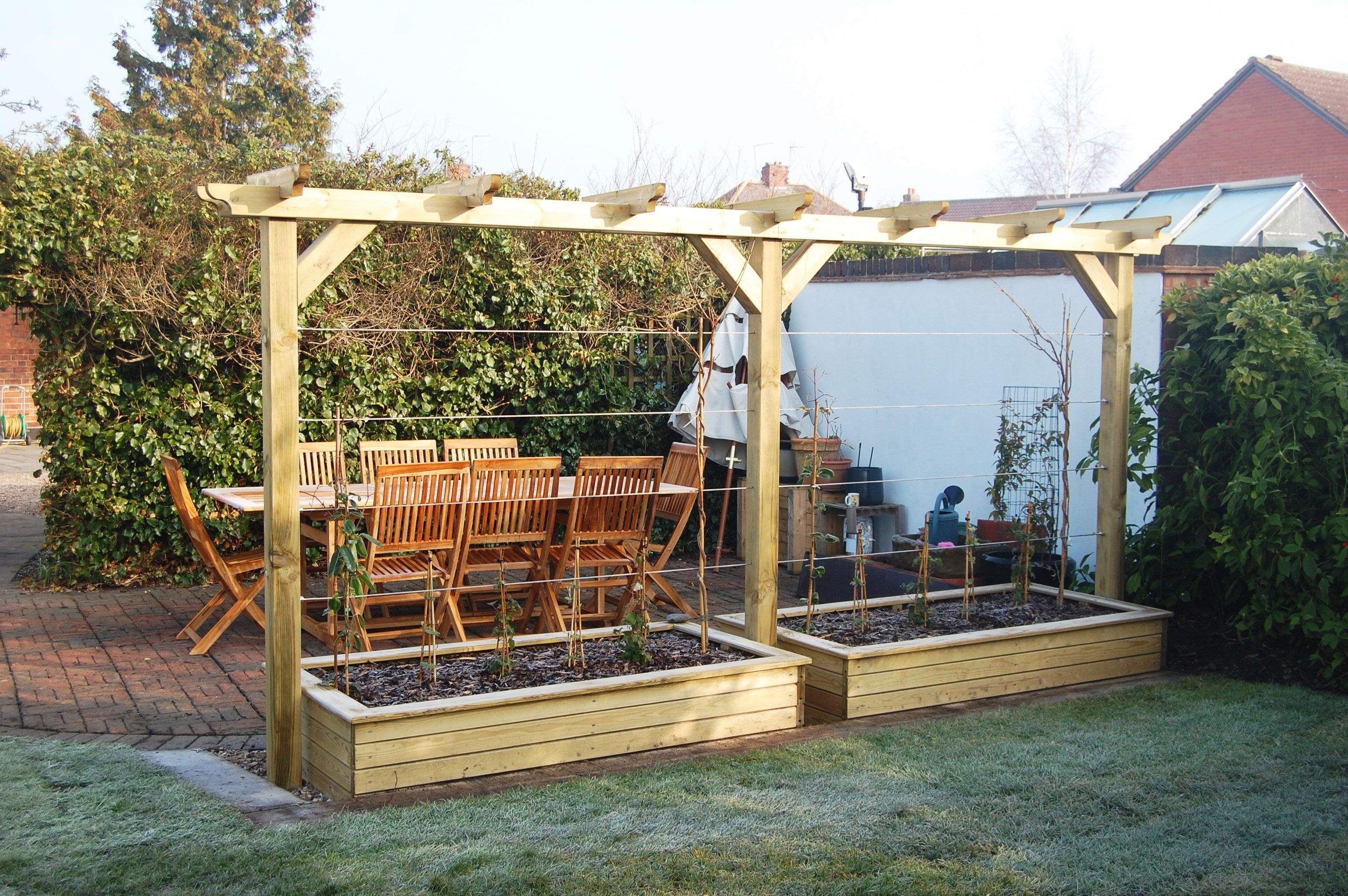 Two raised beds form the base for the single pergola above ... on raised garden bed cold frame, raised garden bed tree, raised garden bed garden, raised garden bed bench, raised garden bed table,