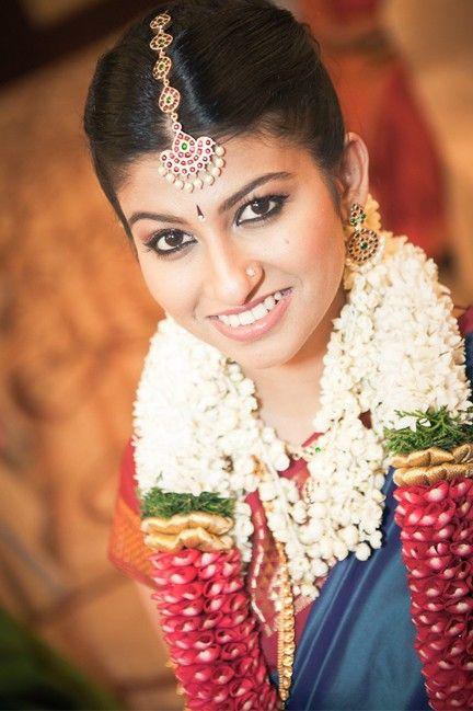 South Indian bride. Gold temple jewelry. Jhumkis.Blue kanchipuram sari.Braid with fresh jasmine ...