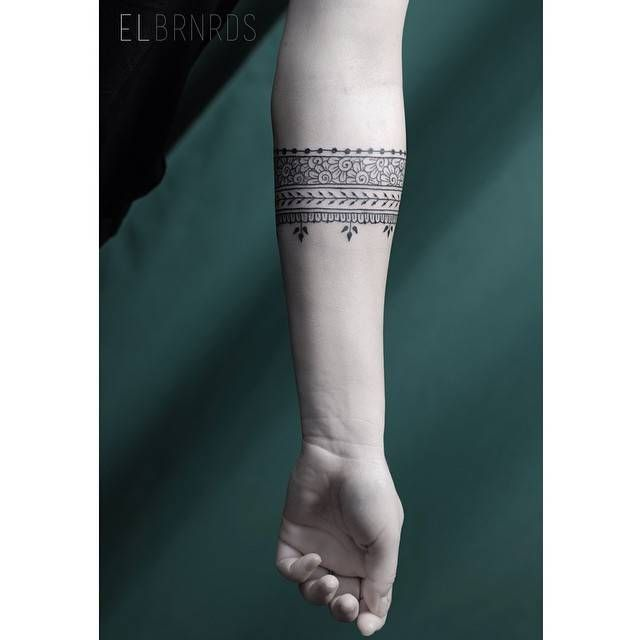 Ornamental Bracelet Tattoo On The Left Wrist Tattoo: Ornamental Style Arm Band Tattoo On The Left Forearm
