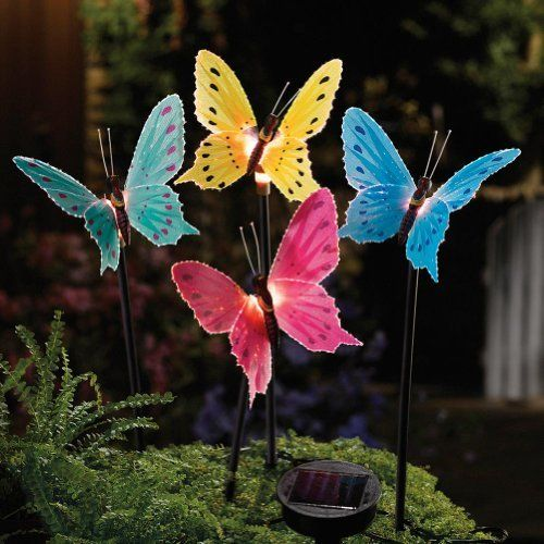 """Solar Fiber Optic Butterfly Garden Stake Lights By Collections Etc by Natures Touch. $16.99. Set of 4 giant butterflies with fiber optic wings. Sparkle with a glow of ever-changing color every evening. Stakes into the ground. Remote solar collector can be located for maximum exposure to sunlight. Each stake is 15 3/4""""H, butterflies are aproximately 6 1/4"""" W. 4 Fiber Optic Butterflies: Set of 4 giant butterflies with fiber optic wings sparkle with a glow of ever-changin..."""