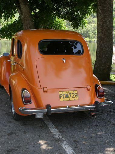 An orange Ford Prefect  at Las Terrazas, Cuba. The