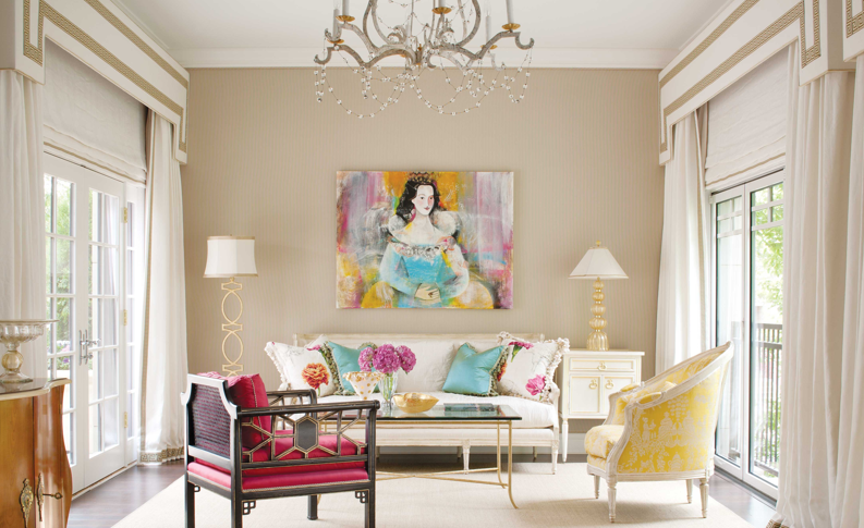 A Matti Berglund painting, commissioned by the homeowner, creates the focal point in the sunroom. The chandelier is by David Iatesta.