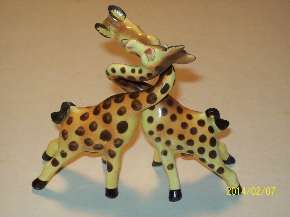 Pair of vintage retro pink ceramic giraffes salt and pepper shakers