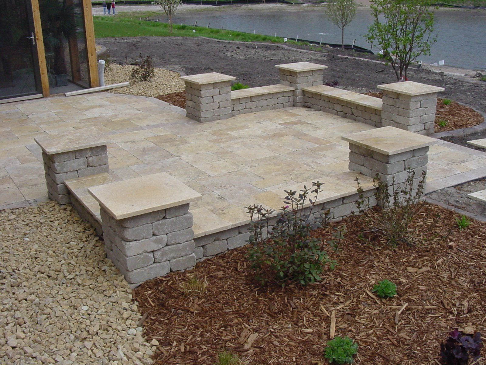Stacked Grey Brick Stone Patio With Green Gr Yard And