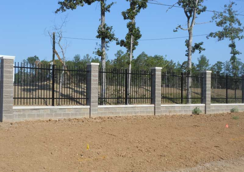 Wrought Iron Fence With Stone Columns Use Cement Blocks For
