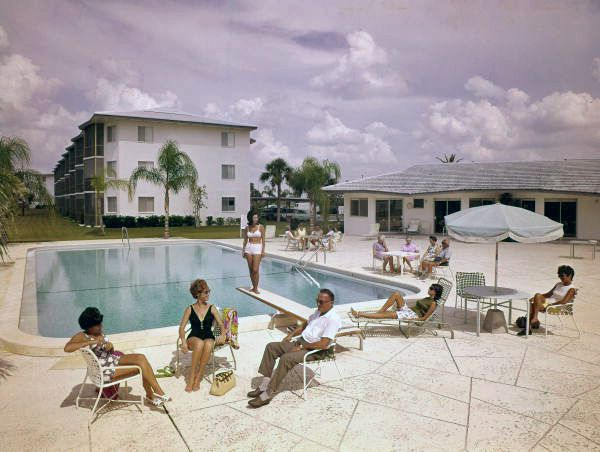 People around the pool at the Sarasota Harbour East Apartments (1967). Photo by Steinmetz. | Florida Memory