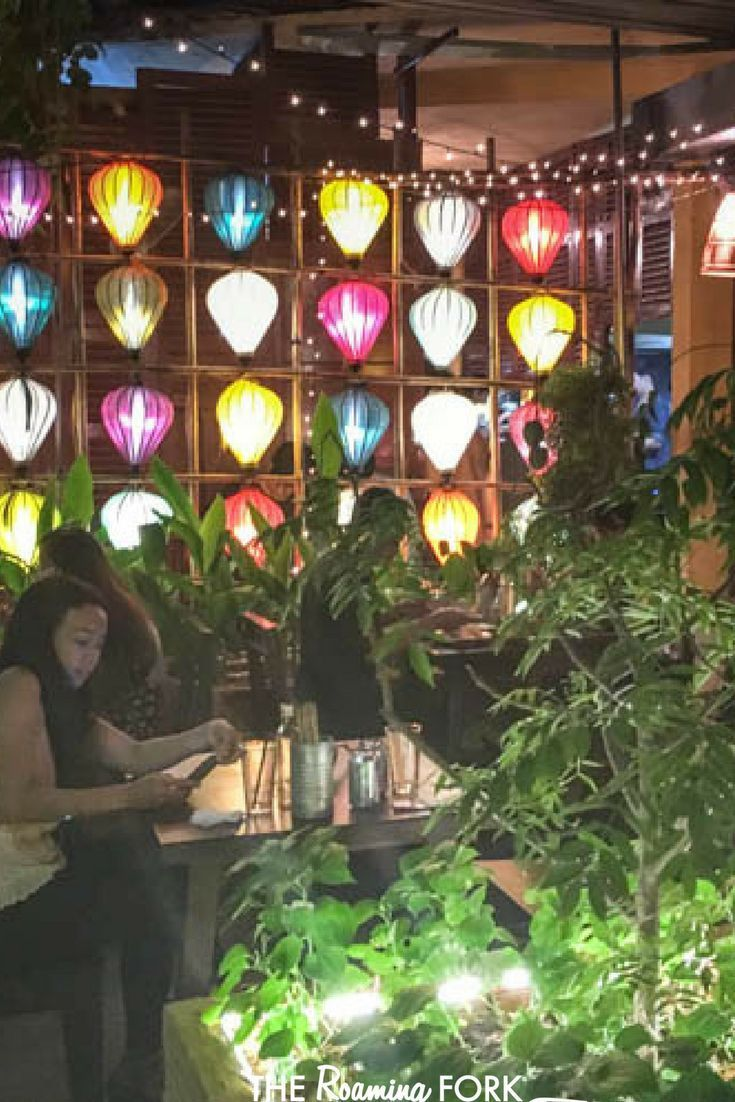 saigon vietnam as the night sky got darker and the city buildings brighter the secret garden put on a light show of its own with a wall of colourful and - Secret Garden Restaurant