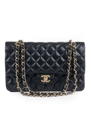 6181d7e23266b3 I had this absolutely amazing Chanel quilted bag. Then my cat decided to  have a fight with it. Vintage Chanel Classic Black ...
