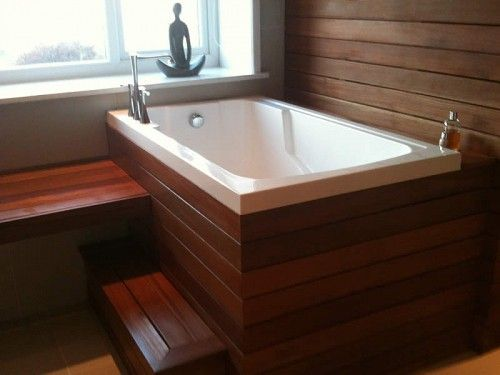 The Nirvana Japanese-style soaking tub with a traditional wooden ...