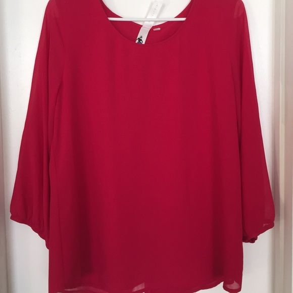 Red blouse Size L. Never worn. Super gorgeous button detailing on the back. Open to reasonable offers. Tops Blouses