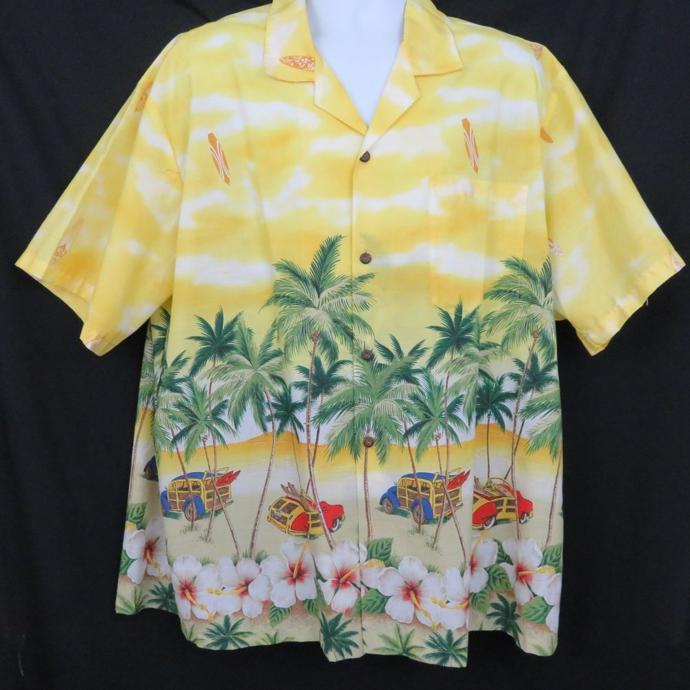 ab5bb137 ... Aloha or Hawaiian Shirt.The shirt features a variegated yellow  background with a bottom border print of woody station wagons, surfboards  and palm trees.