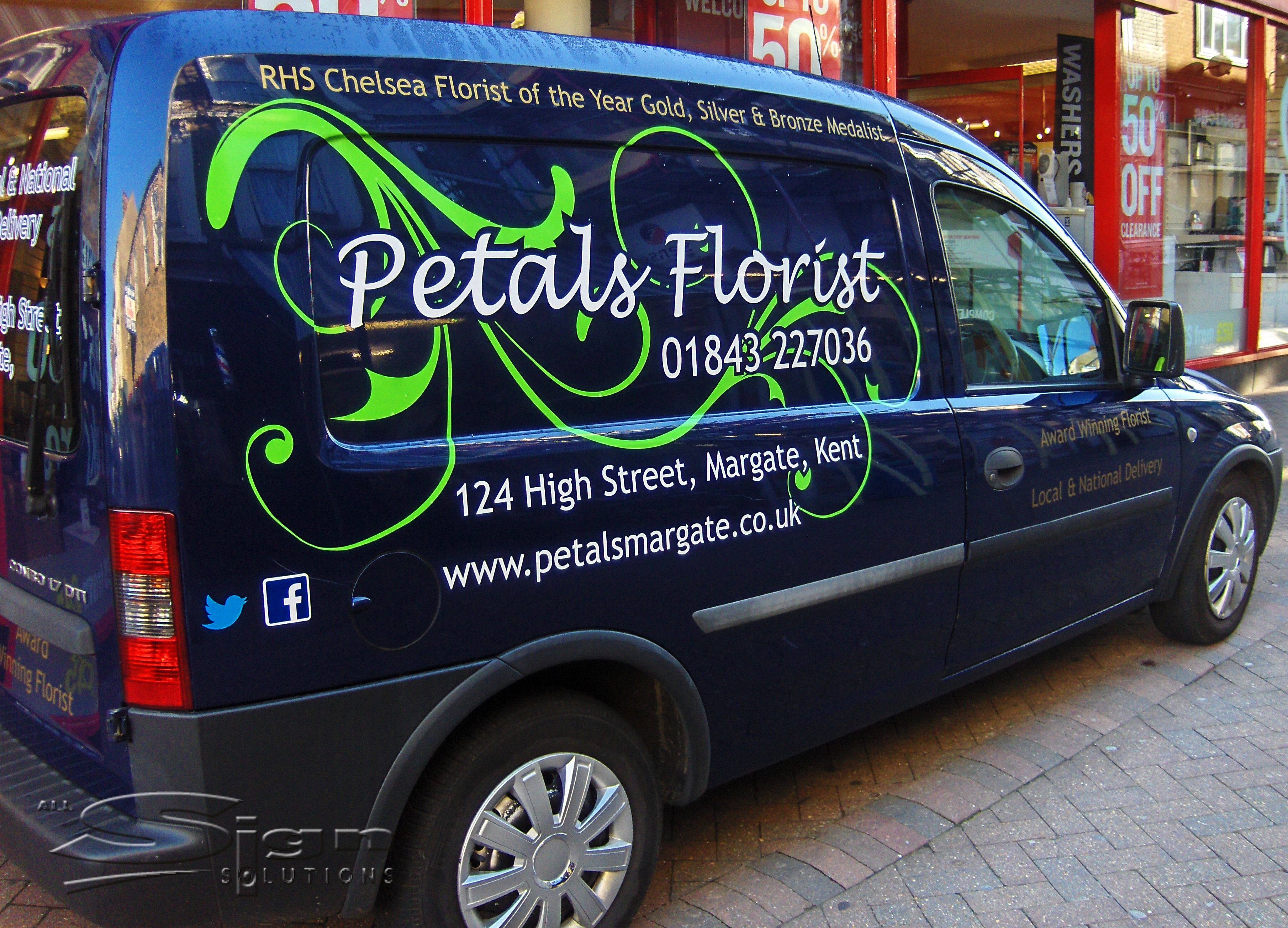 cbd8f8851c Petals Florist in Margate vehicle livery design uses a handwritten styled  font and the colours blue and white. The vivid green swirl stands out on the  dark ...