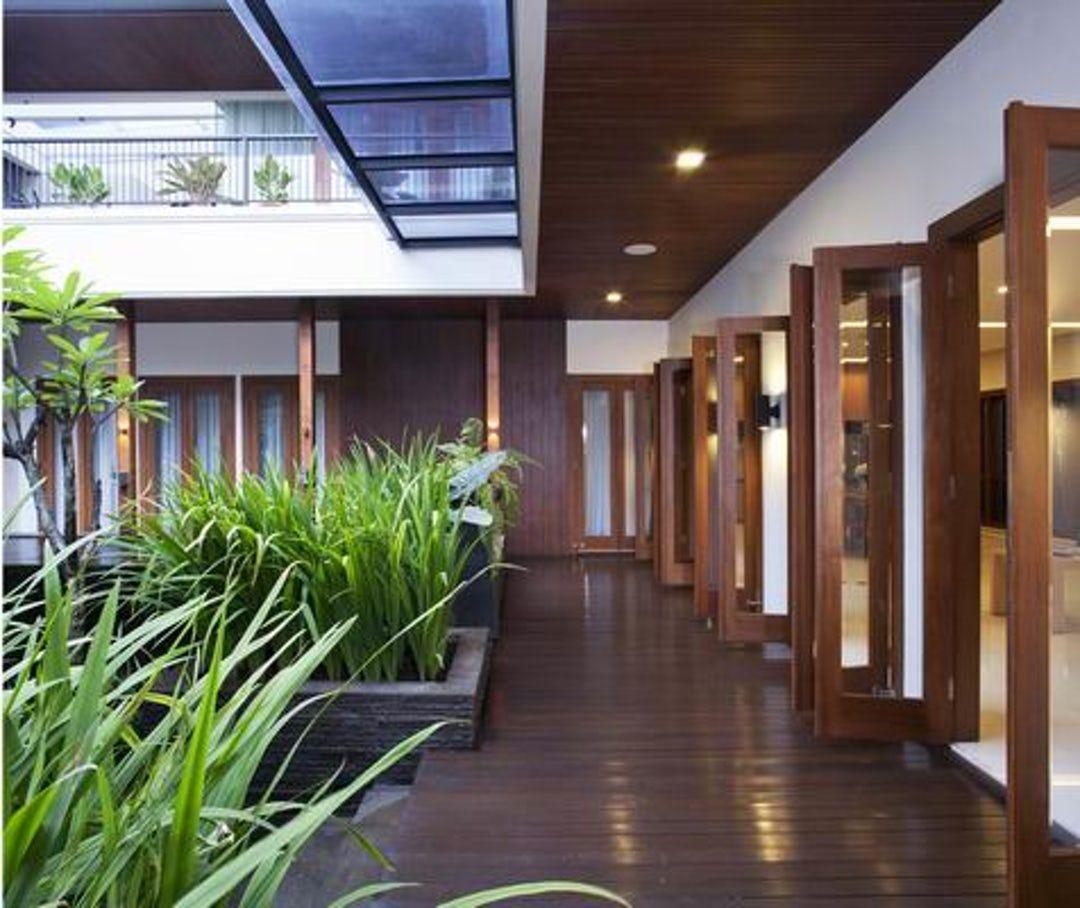 Modern House Exterior Design Modern Tropical House Design: BALI MODERN HOUSE, Pantai Indah Kapuk (August 2009) For