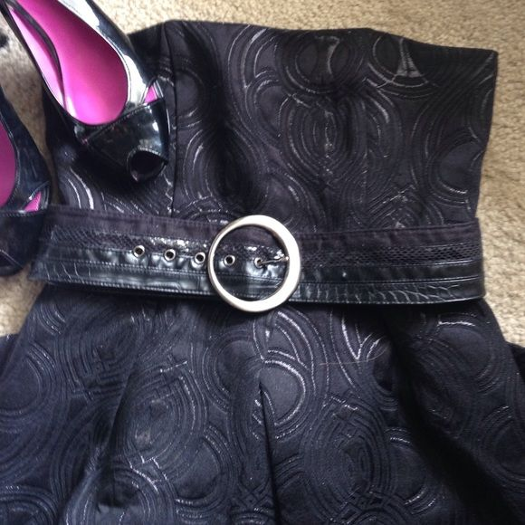 Black Strapless Dress with Pockets Really cute dress with pockets! Let me know if you have any questions! Slip underneath has a tear but you can't tell when worn. Price reflected. Limited Dresses Strapless