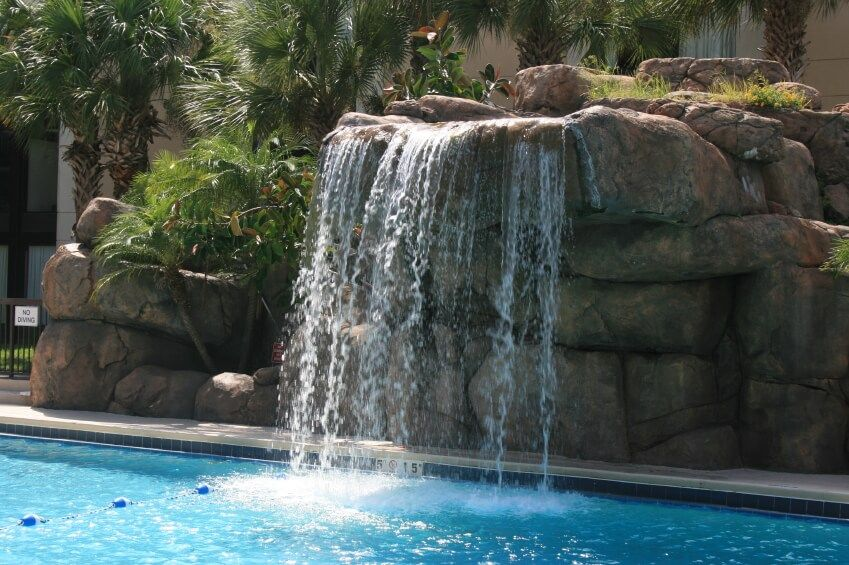 80 Fabulous Swimming Pools With Waterfalls Pictures Pool Waterfall Backyard Pool Landscaping Luxury Swimming Pools