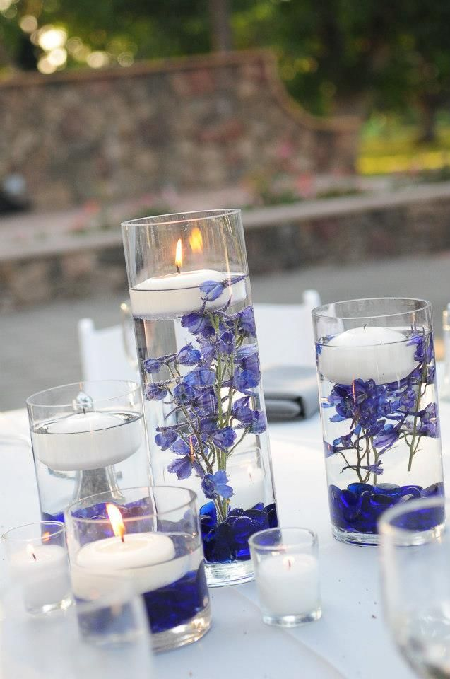 Floating candles flowers and centerpieces