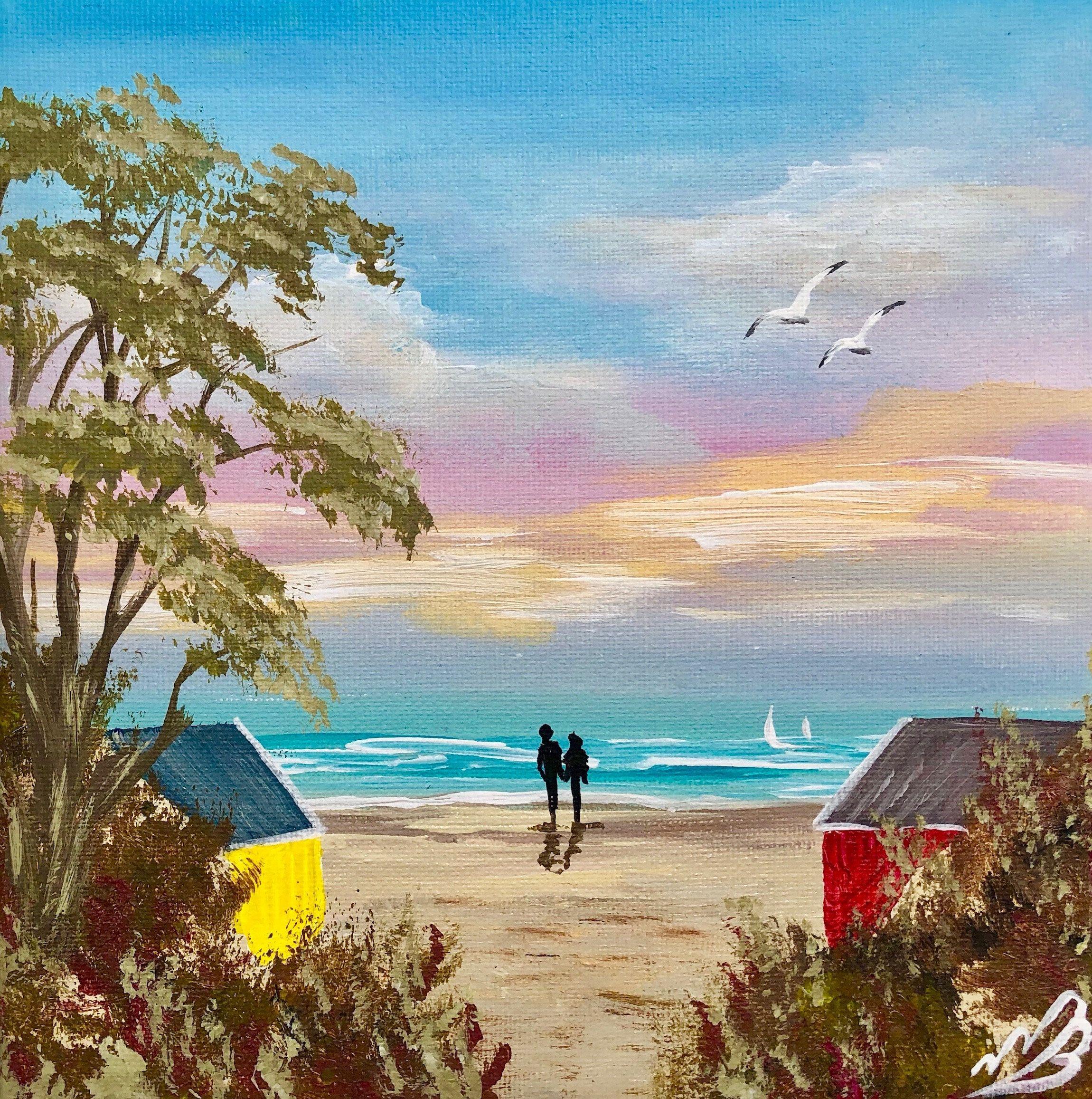 Beach huts in a cove original romantic sunset beach scene