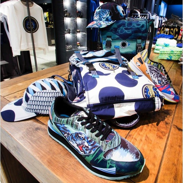 Inside one of our four concept stores in Puerto Banús: Kenzo dot, multi logo and flying tiger prints mix & match in ELITE Man! http://www.elitestore.es