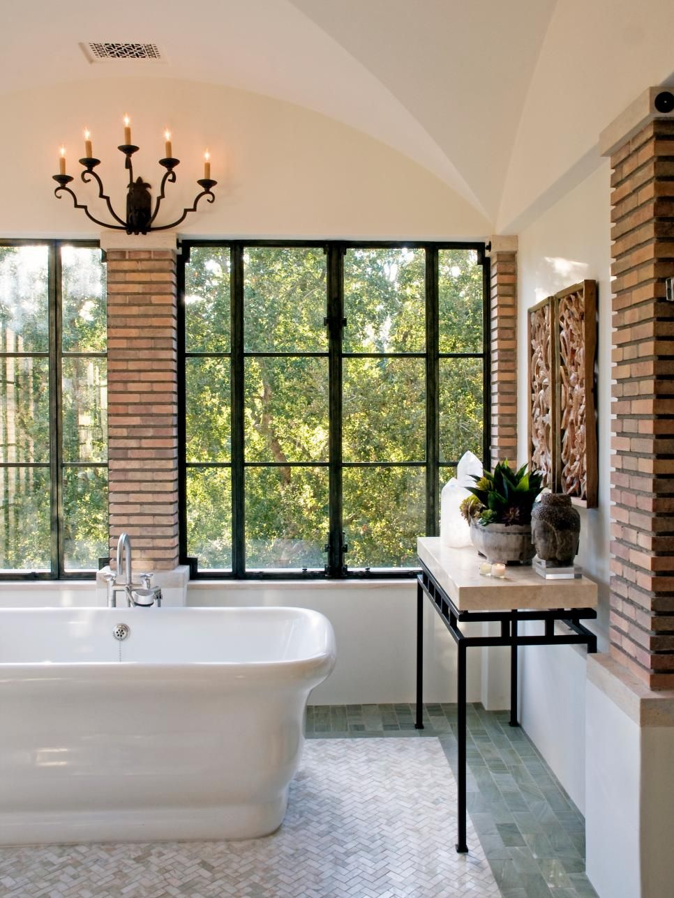 The brick columns contrast with the white walls and make
