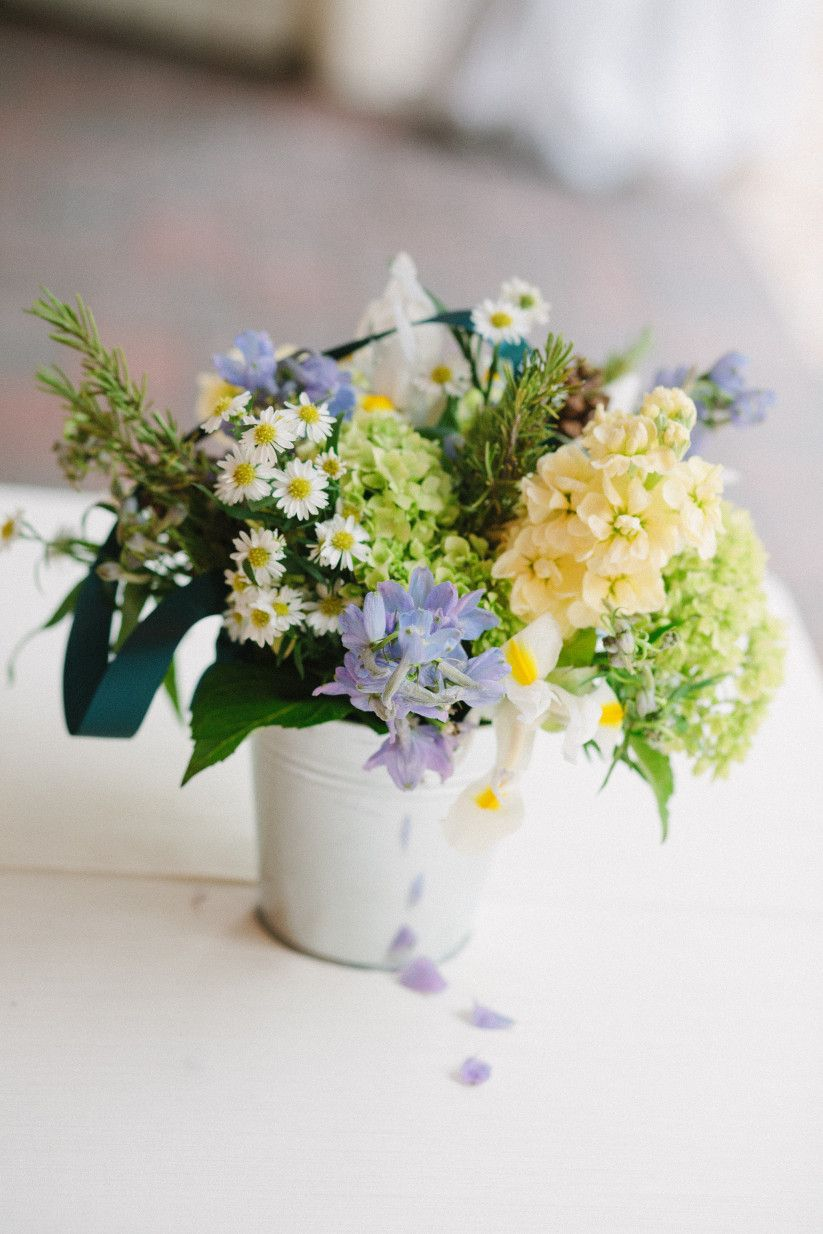 Wedding decoration ideas for tables  Wildflower centerpiece in metal pail  rustic wedding table