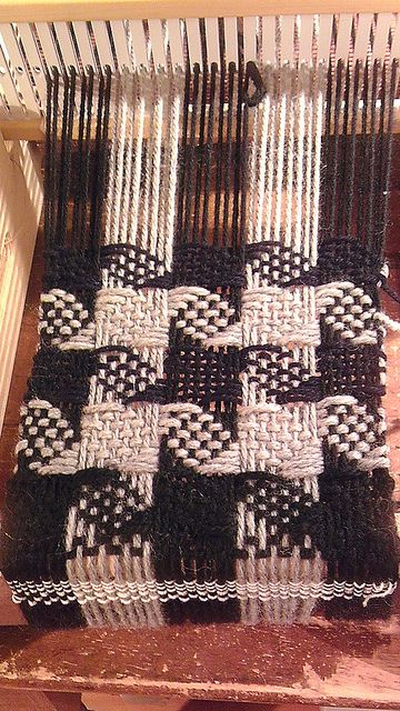 I wove this pattern on an 8 harness loom. I can't imagine doing it