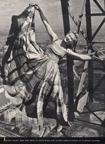 Lisa Fonssagrives in Lucien Lelong swinging precariously off the Eiffel Tower, 1939, Erwin Blumenfeld