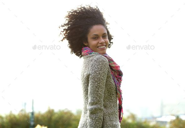 Attractive young mixed race woman smiling by mimagephotography Portrait of an attractive young mixed race woman smiling