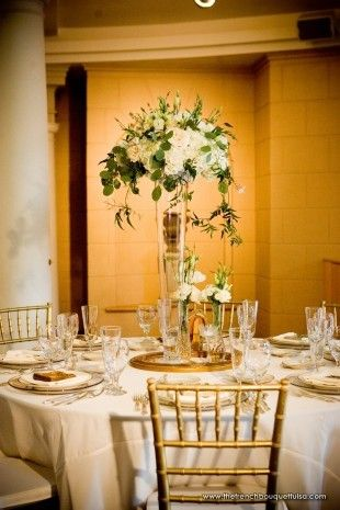 Romantic White Centerpiece Of White And Green In Tall Clear Glass