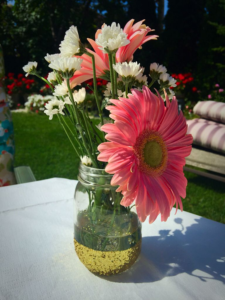 Pink and gold bridal shower. DIY mason jars. Gold glitter, pink and white flowers.