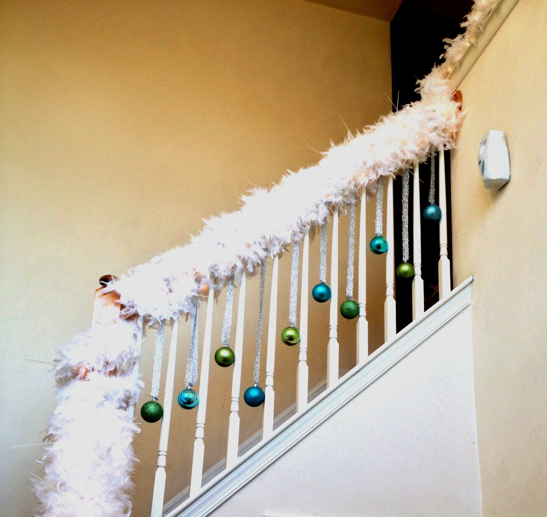 Christmas white feather garland with blue green hanging for Hanging garland on staircase