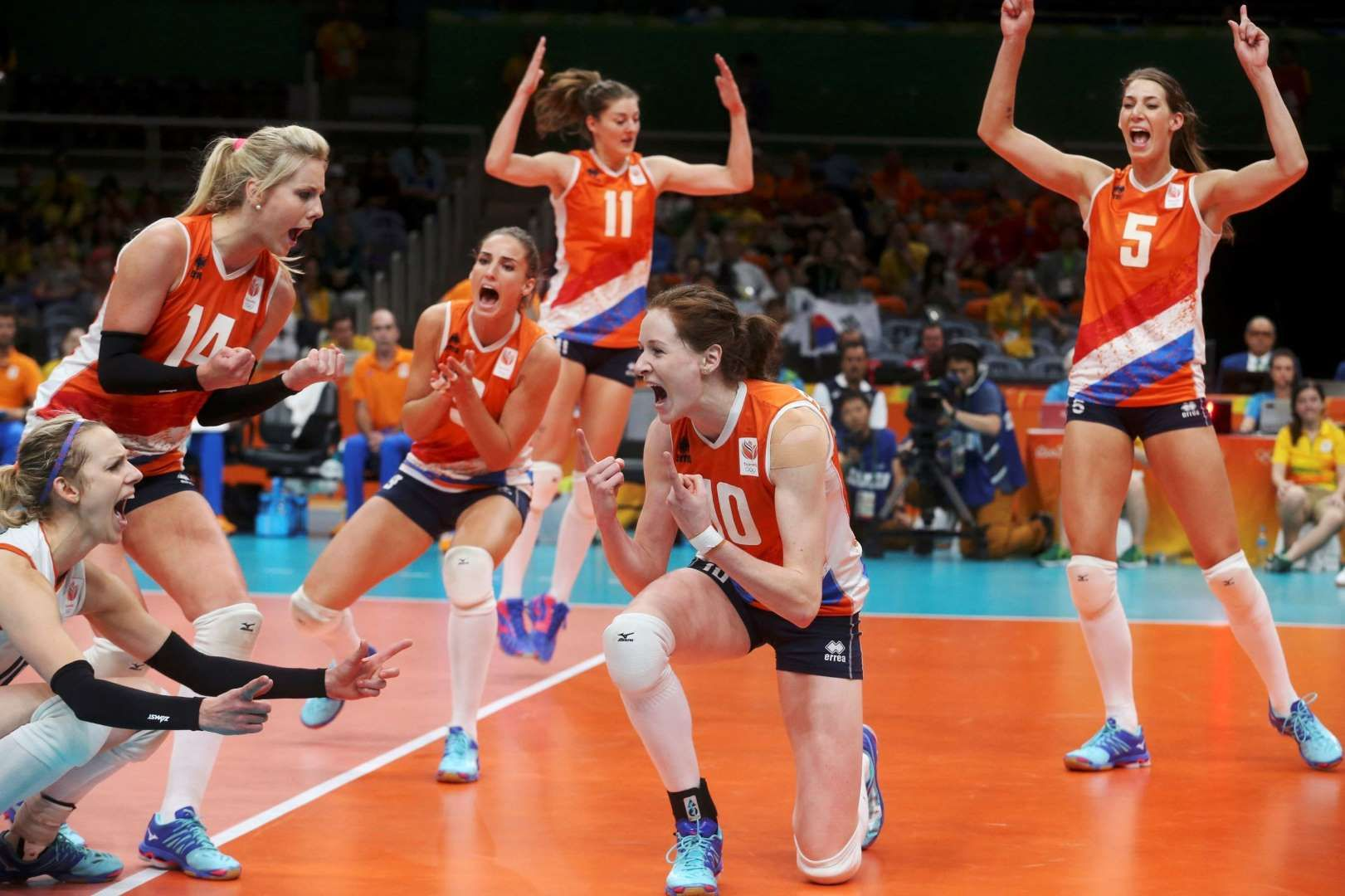 The Thrill Of Victory Dutch Players Celebrate After Defeating South Korea In The Women S Volleyball Q Olympic Volleyball Female Volleyball Players Olympics