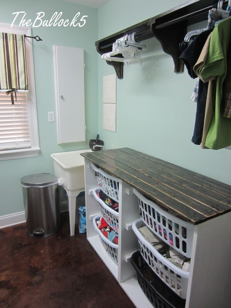 Laundry Table Ideas love the laundry room art and a laundry folding table with basket storage for each Love This Idea Sorting Baskets And You Have A Folding Table