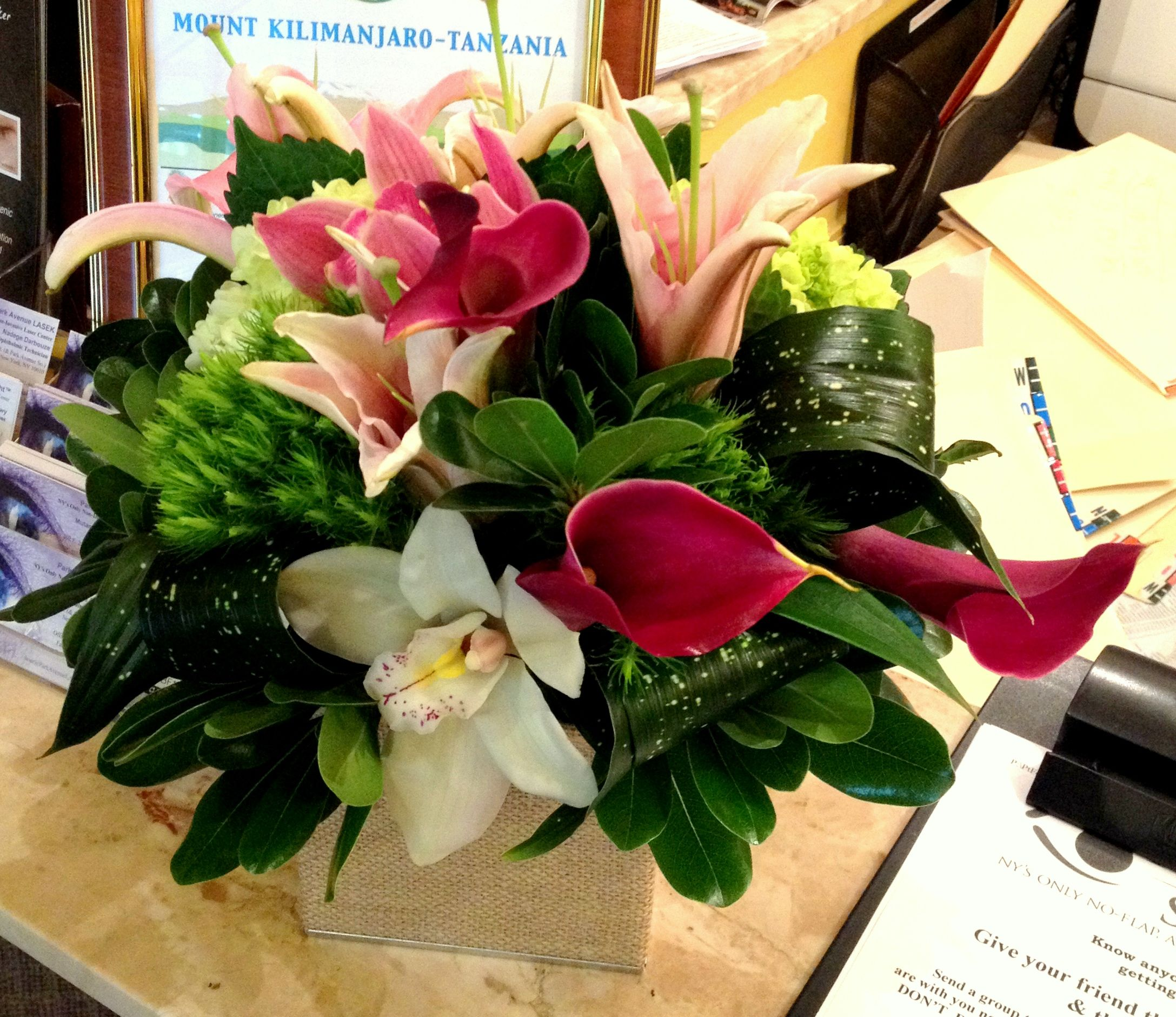 Receiving flowers at work is sure to brighten the day of