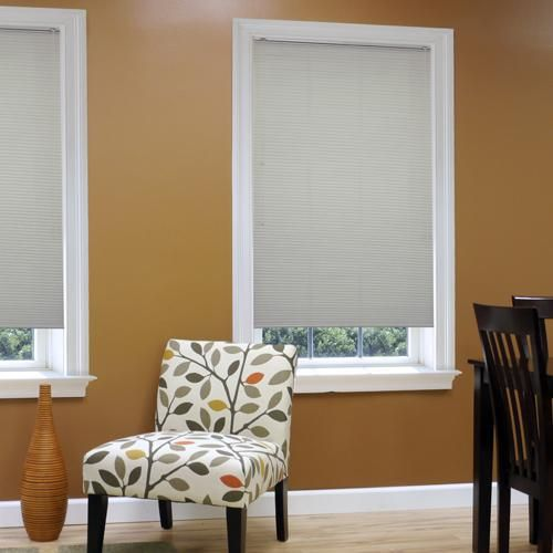 How To Stop Window Drafts With Insulating Window Shades Window Treatments Living Room Honeycomb Shades Living Room Windows