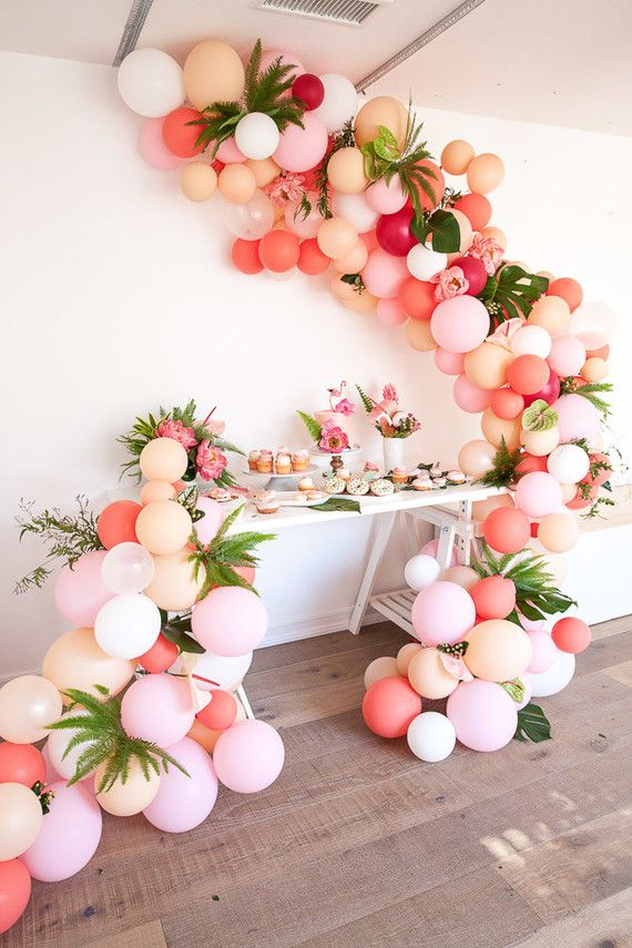 pink balloon installation over the dessert table