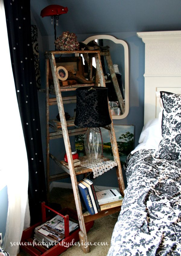 I absolutely love this idea of using an old ladder for a bedside table.