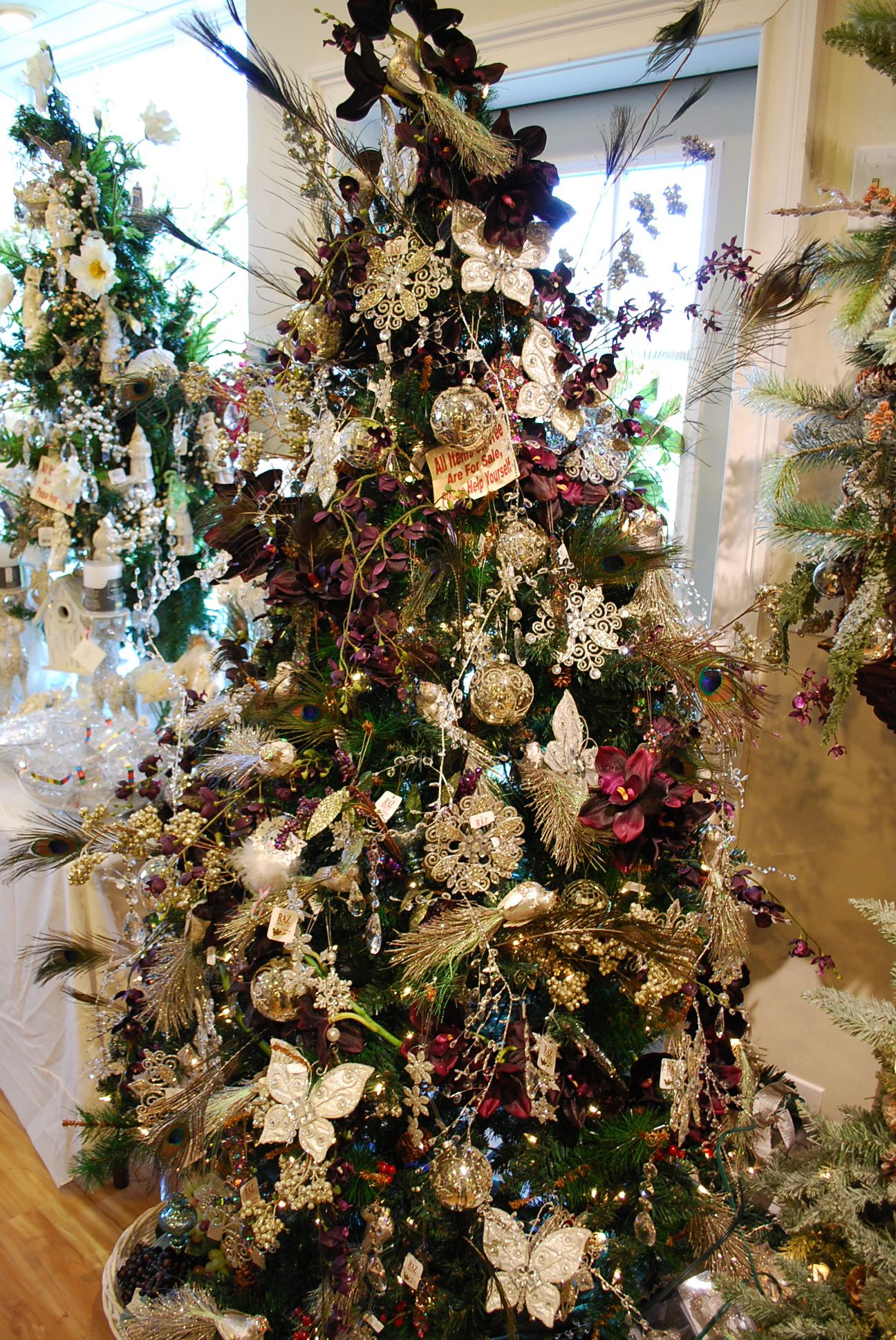 Orchid Christmas Tree.Christmas Tree Decorated With Peacock Feathers Silver Bird