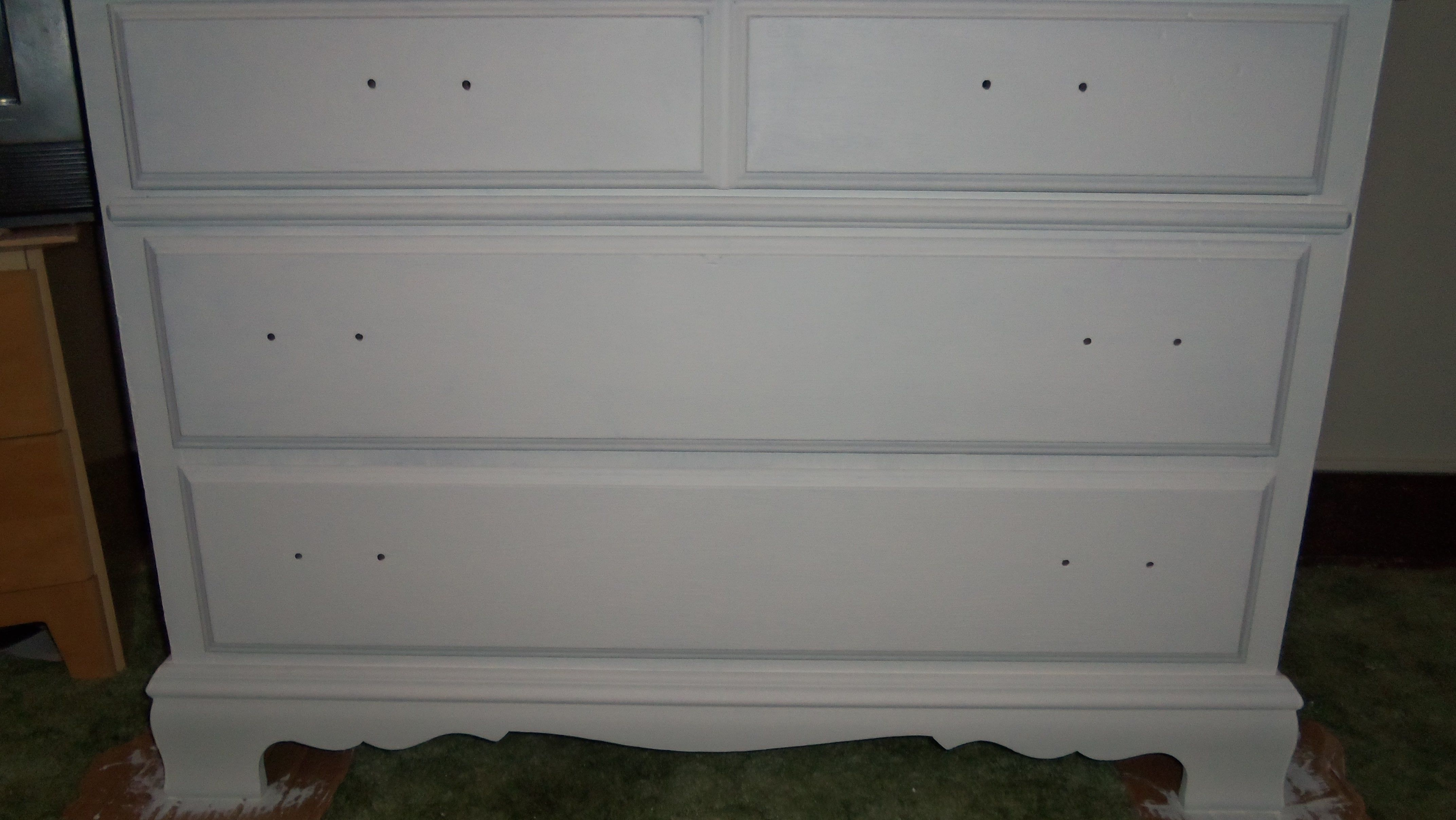 This was an old brown wooden dresser w brass look drawer pulls that