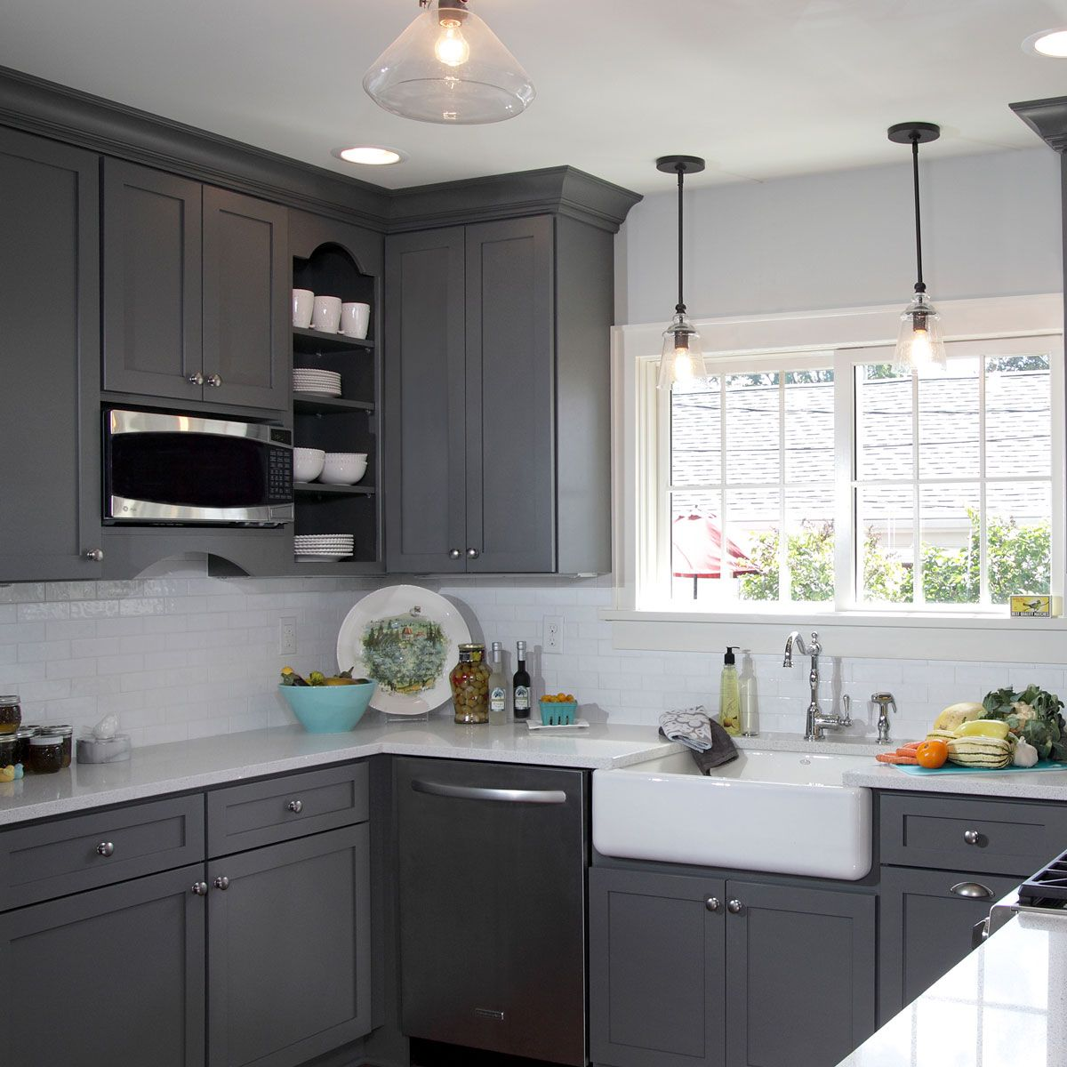 This gorgeous light french gray sw 0055 kitchen has us for Grey kitchen cabinets what colour walls