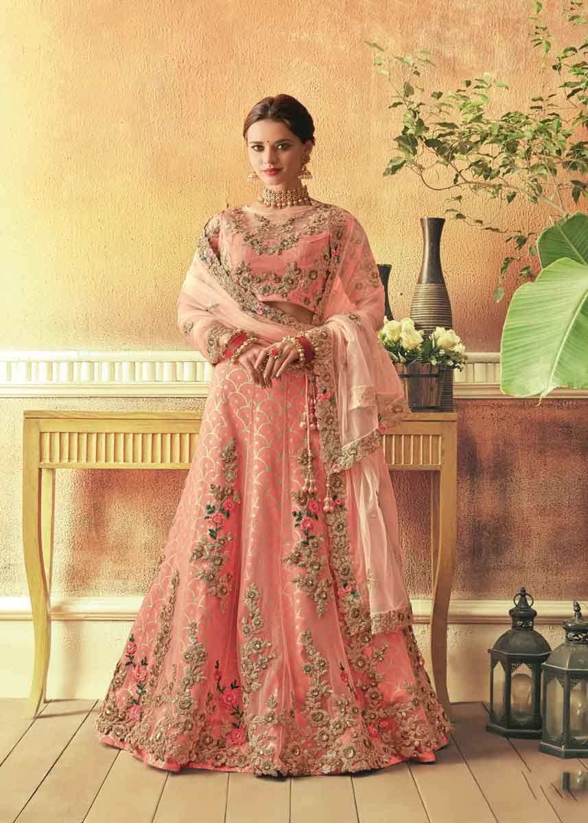 d803fe3a20 Stunning Peach Color Raw Silk And Net Lehenga in 2019 | Wedding Wear ...