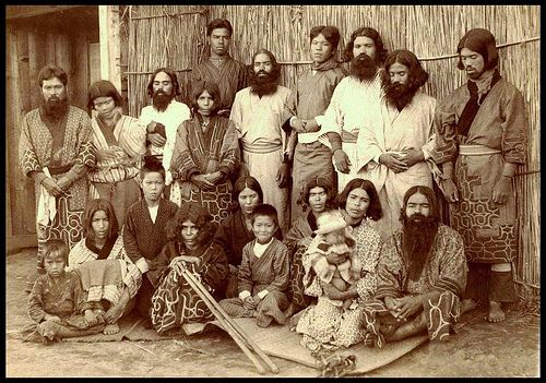 "TWENTY NATIVE AINU IN HOKKAIDO, JAPAN by Okinawa Soba, via Flickr. Ca. 1890-1900 albumen print of a fine group of Ainu who look ""none too happy"" about having their photo taken --- except for that little kid sitting right in the middle who looks like he's trying to smother a good laugh."
